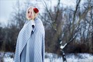 Портретная фотосессия в зимнем лесу.
